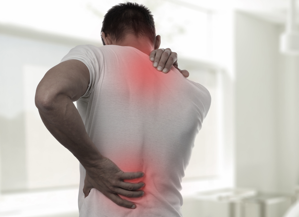 Man with myofascial pain and trigger point pain on his back